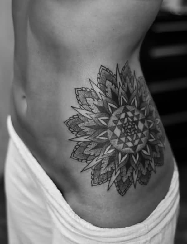 Grey Ink Big Mandala Tattoo On Girl Rib Side